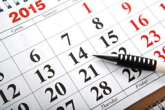 Wall calendars with pen laid on the table Stock Photography