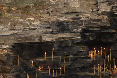 Wall with candles. Stone wall and lit candles Stock Photos