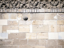 Wall with cannon ball. Detail of church wall with an encased, medieval war vestige,  cannon ball Royalty Free Stock Photo