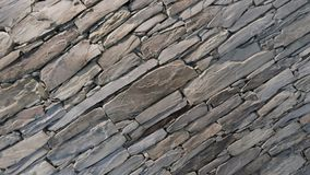 Wall of carefully stacked nature stone pieces. stock image
