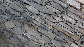 Wall of carefully stacked nature stone pieces. royalty free stock image