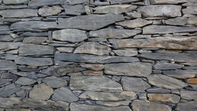 Wall of carefully stacked nature stone pieces. stock photo