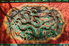 Wall with carved murals of dragon Royalty Free Stock Photography