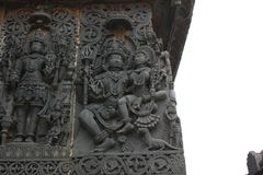 Hoysaleshwara Temple wall carving of Lord Shiva and Parvati god and goddess carving Stock Photo