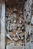 Hoysaleshwara Temple wall carving of Lord Shiva and Parvati god and goddess carving Royalty Free Stock Photos