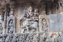 Hoysaleswara Temple wall carving of Lord Uma Maheswara lord shiva and parvati. This is a wall carving of Lord Uma Maheswara lord shiva and parvati. This carving Royalty Free Stock Photo