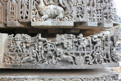 Hoysaleswara Temple wall carved with Makara mythical animal and warriors. This is a wall carving of Makara mythical animal and warriors. This carving is in Royalty Free Stock Images