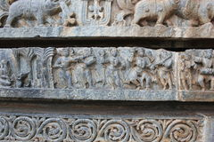 Hoysaleswara temple wall carving of musicians and dancers. This is wall carving of musicians and dancers. This carving is in Hoysaleswar temple, Halebidu stock photo