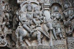 Hoysaleswara Temple wall carving of Uma Maheswara lord shiva and parvati Stock Images
