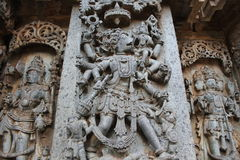 Hoysaleswara Temple Wall Carving of Varaha moorthy Boar face god saving mother earth. This is the Wall Carving of Varaha moorthy Boar face god saving mother stock image