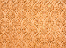 Wall Carvings in the Alhambra of Granada, Spain. Arabic stone wall carvings in the Narid Palaces of the Alhambra of Granada, Spain royalty free stock images