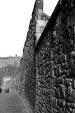 Wall and Castle. Edinburgh Castle viewed from the South along a part of the ancient Flodden Wall Royalty Free Stock Image
