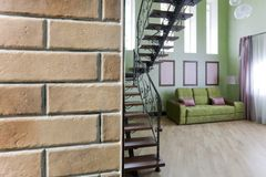Wall with ceramic, facing brick and interior with a metal staircase stock photography