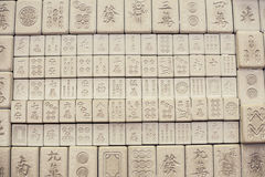 Wall of chinese characters on bricks Stock Photos