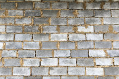 The wall of cinder blocks. Wall of ill-stacked cinder blocks Stock Images