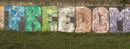 The wall with city graffiti. Graffiti may also express underlying social and political messages stock image
