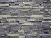 Wall cladding made of cement artificial stone slabs. Colors are gray and pale yellow. Iit`s used both for interior than for exterior stock images