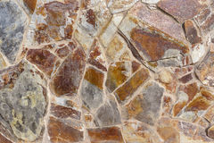 Wall cladding made of stone. Detail of a wall cladding made of coarse stones Royalty Free Stock Photography