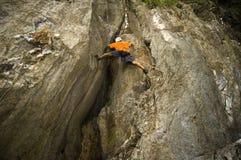 Wall Climber. Man rock climbing in one of El Nido's limestone walls Stock Photo