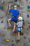 Wall climbers. Kids practicing climbing stock photography