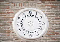 Wall Clock. On the facade of an ancient construction Royalty Free Stock Photos