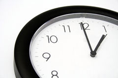 Wall Clock. Clear Wall Clock pointing at one Royalty Free Stock Image