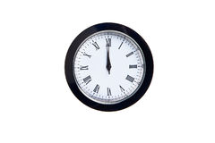 Wall clock. Wall mounted clock with 12:00 hours on it Royalty Free Stock Images