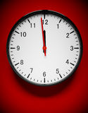 Wall clock. 3D redner of a wall clock on red Stock Photos