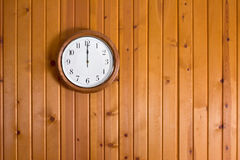 Wall Clock. A clock hanging on a wooden wall Stock Photography