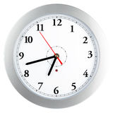 Wall clock. Modern wall clock in silver frame, isolated on white background Stock Photography