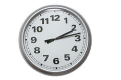 Wall clock. Aluminum wall clock isolated on white with clipping path stock photography