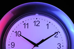 Wall Clock on Black Background Royalty Free Stock Photography