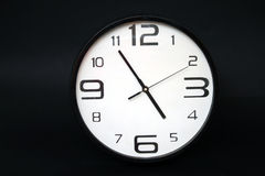 Wall Clock. On a black background Stock Photo