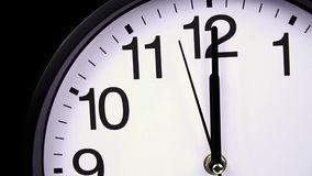 Wall clock on a black 00:00 close-up. Wall clock on a black 00,00 close-up stock footage