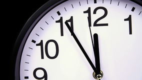 Wall clock on a black 23:55 close-up. Wall clock on a black background 23:55 close-up stock footage