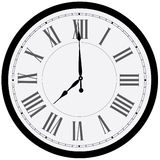 Wall clock. Black wall clock  . Clock on wall shows eight o'clock. Roman numeral clock Stock Photography