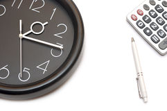 Wall clock and calculator Royalty Free Stock Photography