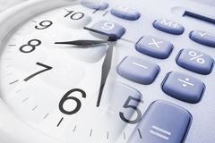 Wall Clock and Calculator Royalty Free Stock Photo