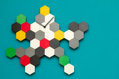 Wall clock. A colourful artistic looking wall clock with hexagon tiles Stock Photos