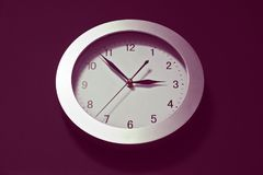 Wall clock, dial with arrows, soon three hours. Oval. Wall clock, dial with arrows, soon three hours. Minute, hour and second hands. oval shape, shadows, hue royalty free stock photos