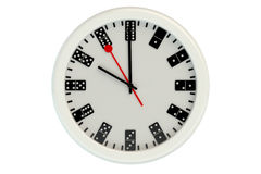 Wall clock with dial of dominoes Stock Photo