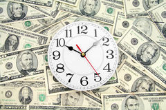 Wall clock and dollars Stock Image