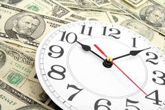 Wall clock and dollars Stock Photography
