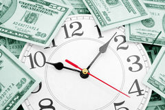 Wall clock and dollars Royalty Free Stock Image