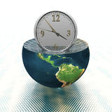 Wall clock on the earth hemisphere Stock Images