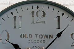 Wall clock face. A modern clock face on white wall royalty free stock photos