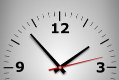 Wall clock on a gray background Stock Photography
