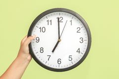 Wall clock in the hand Royalty Free Stock Photo