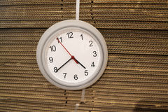 Wall clock hanging on the carton boxes. Carton box from side textures Stock Photo