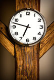 Wall clock hanging on wooden construction Stock Images